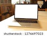 laptop mockup on white desk... | Shutterstock . vector #1276697023