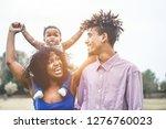 happy african family having fun ... | Shutterstock . vector #1276760023