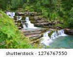 waterfall in ordesa and monte... | Shutterstock . vector #1276767550