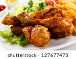 grilled chicken legs with chips ... | Shutterstock . vector #127677473