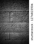 stone wall background in black...   Shutterstock . vector #1276823506