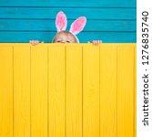 funny kid wearing easter bunny. ... | Shutterstock . vector #1276835740