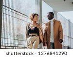 afro couple having walking on... | Shutterstock . vector #1276841290