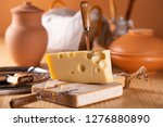 a piece of fresh tasty cheese... | Shutterstock . vector #1276880890