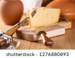 a piece of fresh tasty cheese... | Shutterstock . vector #1276880893