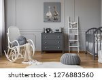 pouf and rocking chair in grey... | Shutterstock . vector #1276883560