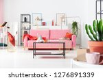 table in front of pink couch... | Shutterstock . vector #1276891339
