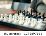 chessboard with a chess piece...   Shutterstock . vector #1276897996