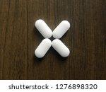 many white oblong medicine... | Shutterstock . vector #1276898320