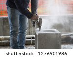 bricklayer at work in a... | Shutterstock . vector #1276901986