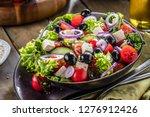 fresh vegetables greek salad ....   Shutterstock . vector #1276912426