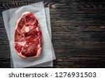 piece of raw lamb meat on dark...   Shutterstock . vector #1276931503