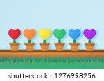 colorful heart in flower pot...   Shutterstock .eps vector #1276998256