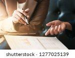 executives negotiating on... | Shutterstock . vector #1277025139