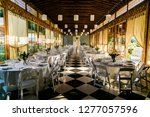 empty plated tables set for a... | Shutterstock . vector #1277057596