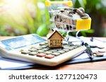 house model on calculator for...   Shutterstock . vector #1277120473