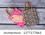 two shopping bags with... | Shutterstock . vector #1277177863