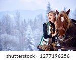 attractive woman in white short ... | Shutterstock . vector #1277196256