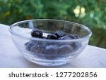 black olives in a glass bowl.... | Shutterstock . vector #1277202856