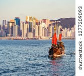 retro small ship in hong kong... | Shutterstock . vector #1277209093