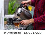 a person makes tea using... | Shutterstock . vector #1277217220
