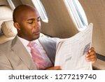 businessman on trip reading... | Shutterstock . vector #1277219740