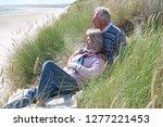 senior couple relaxing in sand... | Shutterstock . vector #1277221453