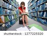 unhappy businesswoman on stool... | Shutterstock . vector #1277225320