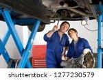 mechanics with car engine part... | Shutterstock . vector #1277230579