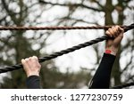 hands gripping rope during... | Shutterstock . vector #1277230759