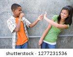 teenage boy flicking rubber... | Shutterstock . vector #1277231536