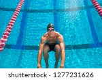 competitive male swimmer on... | Shutterstock . vector #1277231626