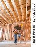 construction worker in hard hat ... | Shutterstock . vector #1277232766