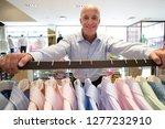 mature man shopping for shirt... | Shutterstock . vector #1277232910