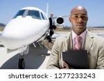 businessman on trip at airport... | Shutterstock . vector #1277233243