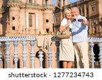 senior couple on city break... | Shutterstock . vector #1277234743
