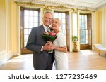 mature couple with bouquet... | Shutterstock . vector #1277235469