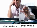 businessman in office with... | Shutterstock . vector #1277237323