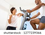 couple exercising on gym... | Shutterstock . vector #1277239366