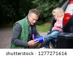 father putting wellington boot... | Shutterstock . vector #1277271616