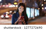 woman use of mobile phone at... | Shutterstock . vector #1277272690