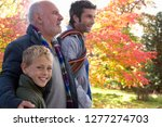 grandfather with adult son and... | Shutterstock . vector #1277274703