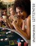 woman in casino showing winning ... | Shutterstock . vector #1277274733