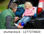 father putting wellington boots ... | Shutterstock . vector #1277274820