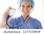 female nurse with stethoscope... | Shutterstock . vector #1277278939