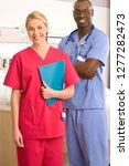 smiling male doctor and female... | Shutterstock . vector #1277282473