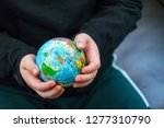 Holding Earth In The Palms Of...