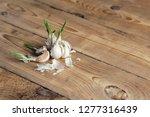 broken non fresh garlic with... | Shutterstock . vector #1277316439