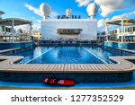 Copenhagen, Denmark - September 12 2018: Cruise ship passengers assemble on the top viewing deck above an empty swimming pool, as the ship nears the Öresund Bridge near Copenhagen, Denmark - stock photo