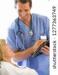 male nurse writing medical... | Shutterstock . vector #1277363749
